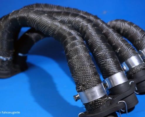Krümmeranlage mit Hitzeschutzband in schwarz
